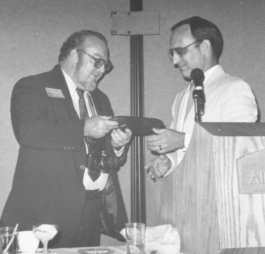 Robert A. Collins receiving the first Robert A. Collins Service Award, 1985, photo courtesy of FAU Special Collections, Robert A. Collins Collection